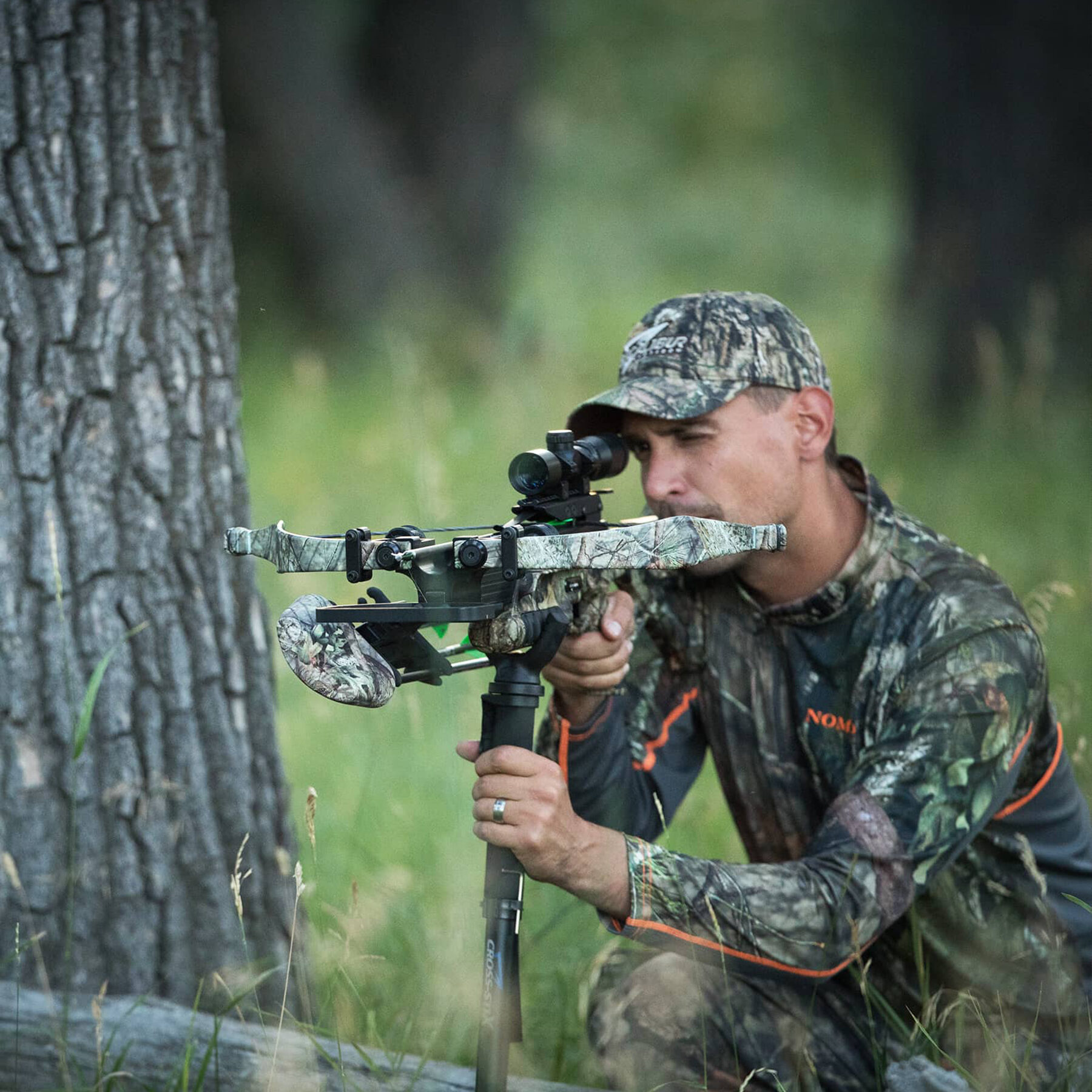 hunter taking aim with a micro 340td mounted on cross stix