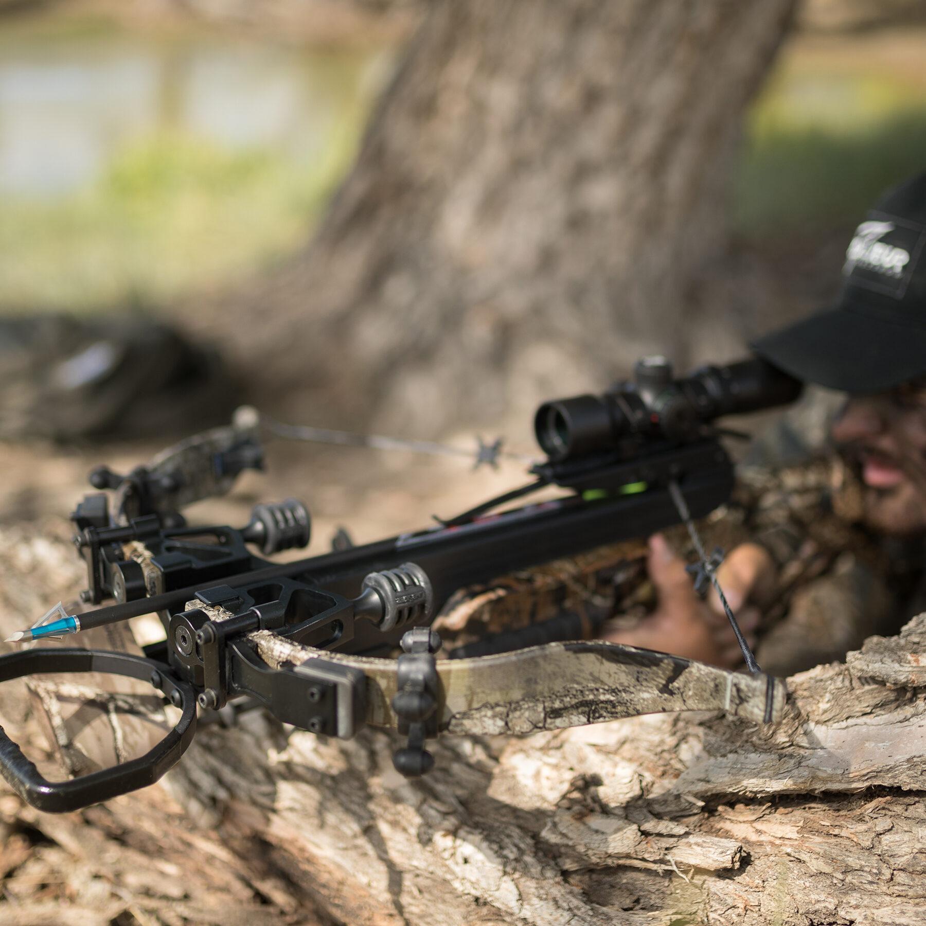 hunter aiming over log with micro 340 td
