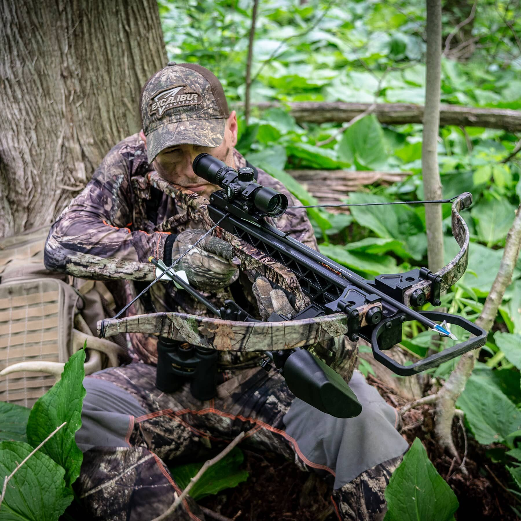 hunter in the woods aiming with a matrix g340